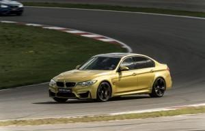 золотой седан M3 новый